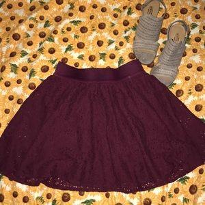 Maroon skirt, flowery lace detail
